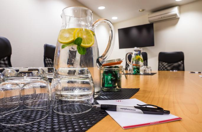 Boardroom table with glasses and lemon water